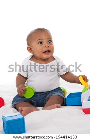 7-month old african american baby  boy playing with toys on white background - stock photo