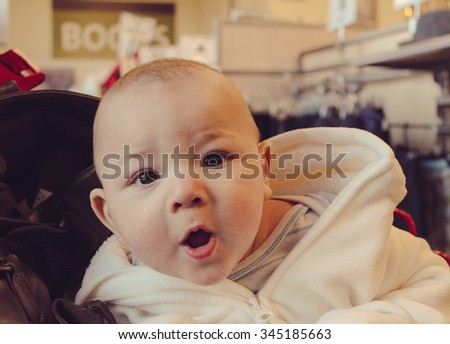6 month old baby boy at a thrift shop - stock photo