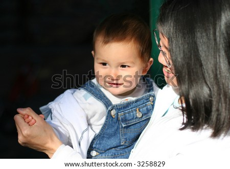 8 months old dancing with mom - stock photo