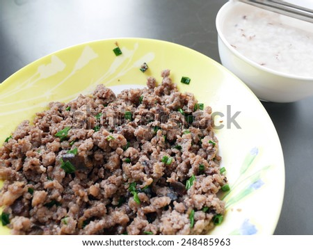 'Moo Pud Num Liab' Thai Breakfast Stir Fried Minced Pork with Salted Olive win Boiled Rice - stock photo