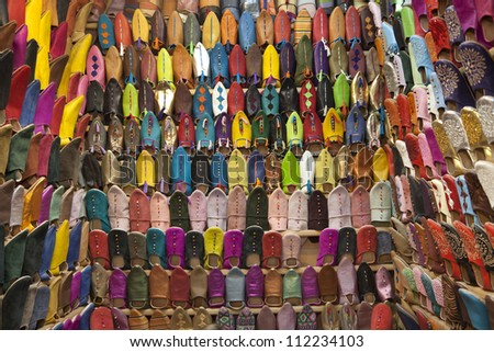 Moroccan slippers for sale in the souk of Marrakesh, Morocco, April 1, 2012 - stock photo