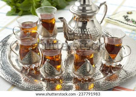 Moroccan tea glasses and pot - stock photo