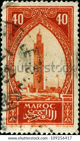 MOROCCO - CIRCA 1934: A stamp printed in  Morocco showsKoutoubia, the biggest mosque of the Moroccan city of Marrakesh, circa 1934 - stock photo