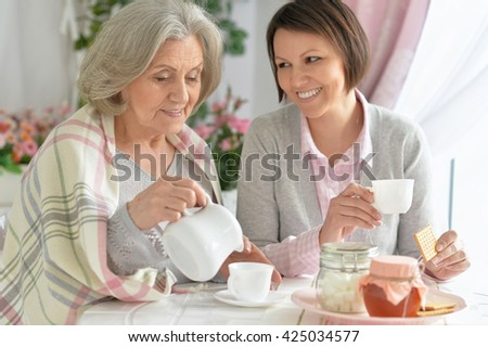 mother and adult daughter - stock photo