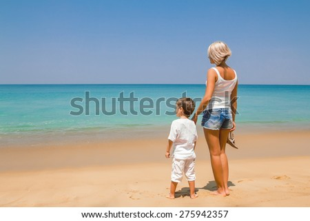 Mother and her son on the beach in Thailand - stock photo