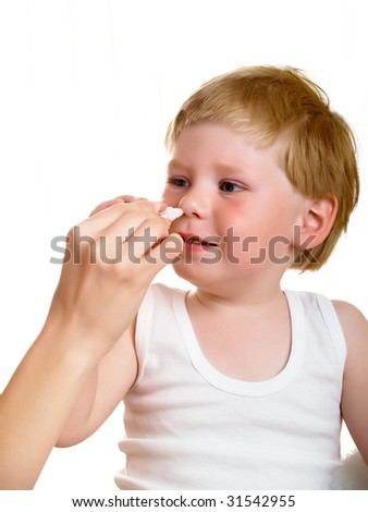 mother earth in the nose drops a sick boy - stock photo