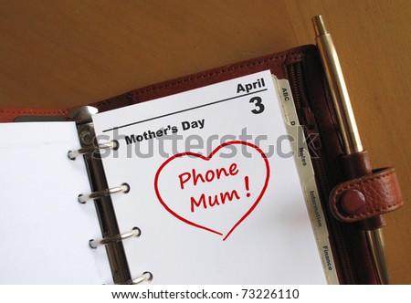 Mother's Day calendar in a personal organiser with a red heart and phone Mum - stock photo