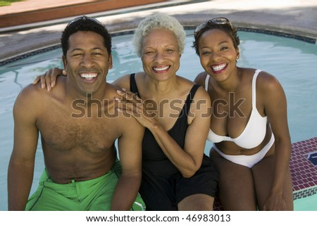 """Mother, Son and Daughter-in-law Poolside"" - stock photo"