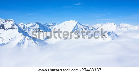mountains under snow in the winter - stock photo