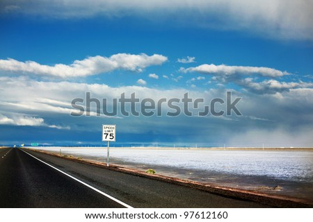 75 MPH Speed Limit sign at dusk in Bonneville Salt Flats, Utah - stock photo