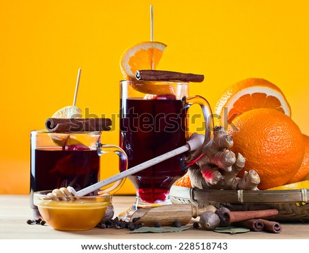 mulled wine with spices , fruits and honey - stock photo