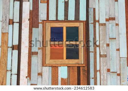 Multicolor glass window and old wood panels - stock photo