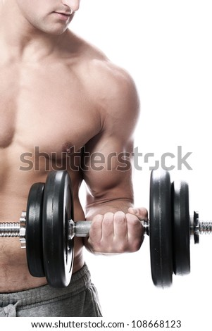 Muscular guy doing exercises with dumbbells over white background - stock photo