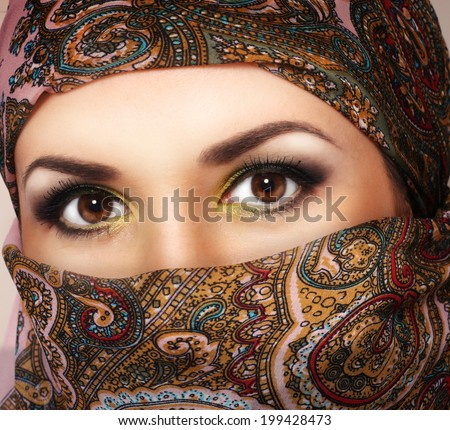 Muslim woman with brown eyes - stock photo