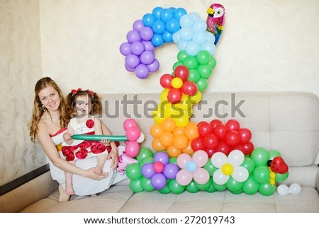2-nd birthday of  toddler girl at home - stock photo