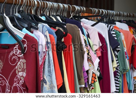 2nd hand sale clothes rack with a selection of fashion for women  - stock photo