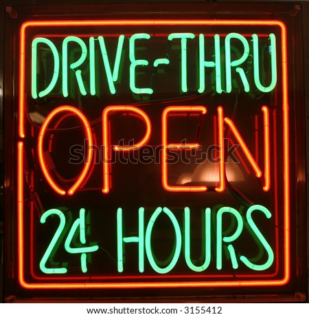 """neon sign"" series ""DRIVE-THRU OPEN 24 Hours"" - stock photo"