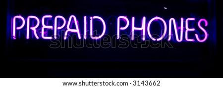 """neon sign series"" ""prepaid phones"" - stock photo"