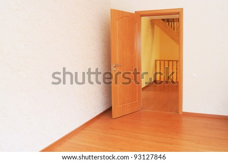 New home. The doors of the empty room on the stairs - stock photo