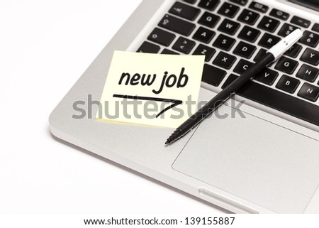 """new job"" written on sticky note, on laptop keyboard. - stock photo"
