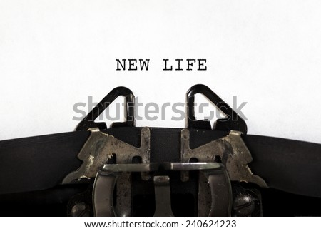 """NEW LIFE""  printed on an old typewriter. - stock photo"