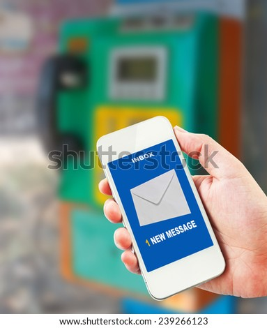 1 new message received on mobile phone.public telephone background. - stock photo