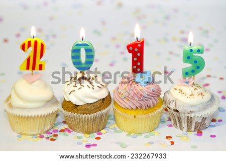 2015 new year cupcakes on abstract colorful background - stock photo