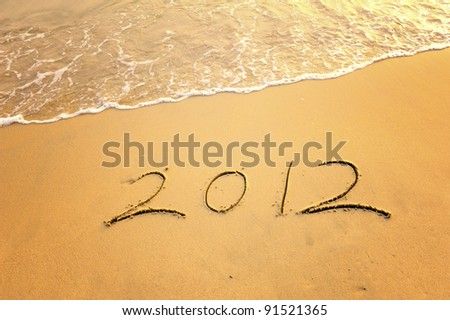 2012 new year message on the sand beach - stock photo