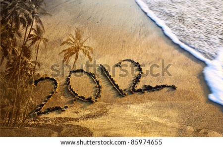 2012 new year message on the sand beach near the ocean with palm trees texture background. Free space for text - stock photo