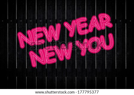 'New Year New You'  pink neon sign  on wood background - stock photo