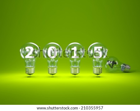 2015 New Year sign inside light bulbs on green background - stock photo