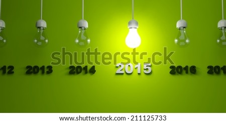 2015 New Year sign with light bulb on green background - stock photo