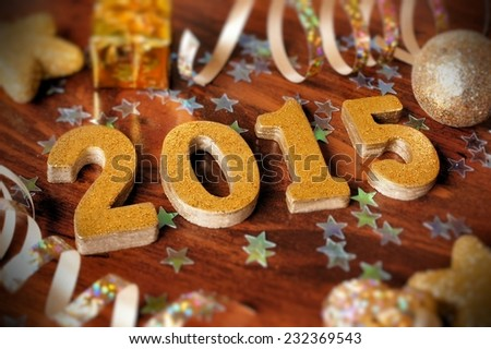 2015 New Years Eve golden numbers with confetti and decorations on wooden background                   - stock photo