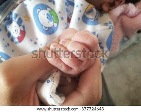 newborn baby and mothers hands with soft focus, love and family concept  - stock photo