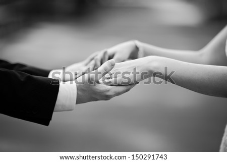 newly wed couple holding hands, marry me ! - stock photo