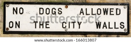'No dogs allowed on the city walls' warning sign. - stock photo