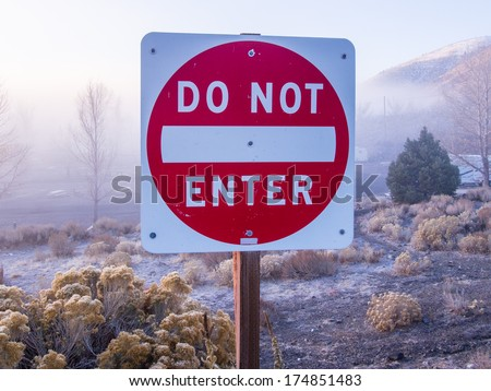 """No entry"" signs are often placed at the exit ends of one-way streets - stock photo"