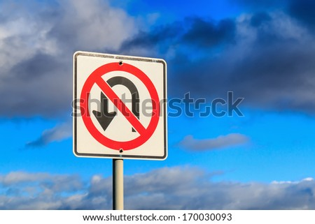 ??No U Turn traffic sign against cloudy sky. - stock photo