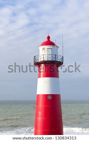 """""""Noorderhoofd""""  lighthouse in Westkapelle, Netherlands. It has 3 colors of light, white (6000 candela), red and green (1800 cd). Together with another lighthouse it sends its  beacon to the """"Oostgat"""" - stock photo"""