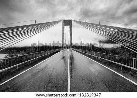 Norway road landscape. Rain on road.Brigde - stock photo