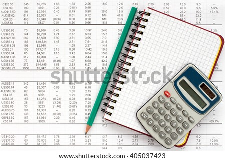 Notebook,pencil and calculator on financial statement , concept of accounting. - stock photo