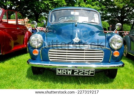 NOTTINGHAM, UK - JUNE 1, 2014: Frontal view of a blue Morris vintage care for sale in Nottingham, England. - stock photo