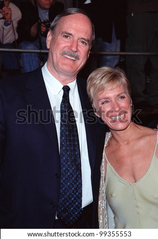 """08NOV99: Actor JOHN CLEESE & friend ALYCE FAYE at world premiere, in Los Angeles, of the new James Bond movie """"The World Is Not Enough"""" in which he plays """"R"""".  Paul Smith / Featureflash - stock photo"""