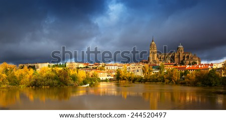 November view of Salamanca with  River and Cathedral. Castile and Leon, Spain  - stock photo