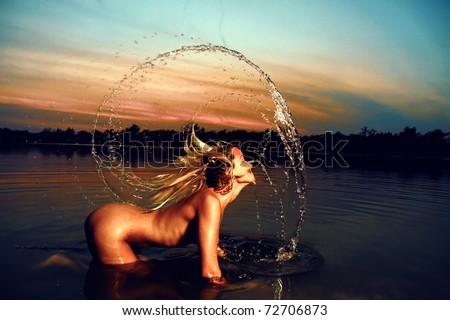 Nude girl water fun - stock photo