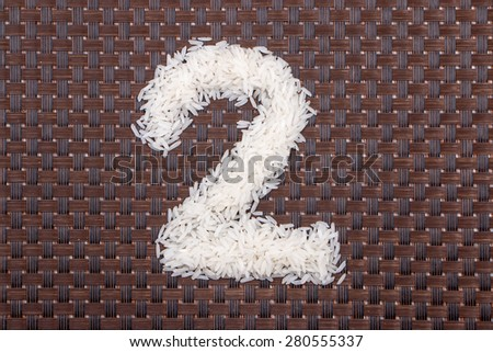 2, number from raw rice - stock photo