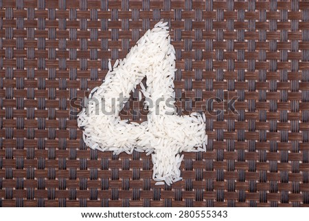 4, number from raw rice - stock photo