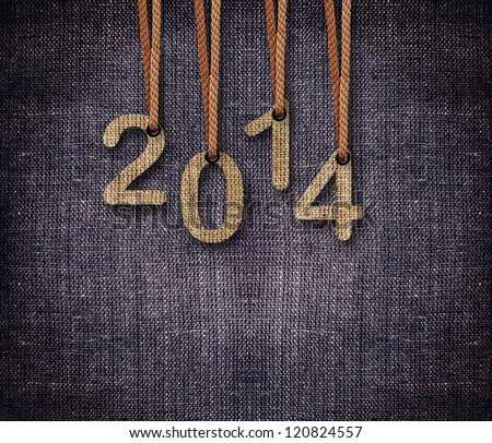 2014 numbers hanging by rope as puppeteer on sackcloth background. - stock photo