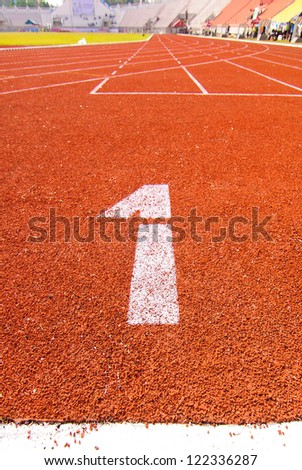 """Numbers """"1"""" on running track at arena. - stock photo"""