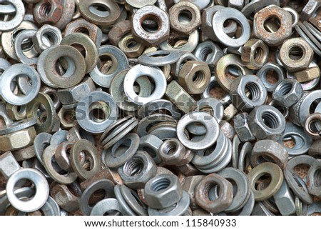 Nuts and washers in a drawer of hardware. - stock photo